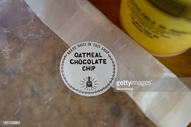 A Potbelly Corp oatmeal chocolate chip cookie and drink cup are arranged for a photograph in Washington DC US on Friday Oct 4 2013 Potbelly Corp the...
