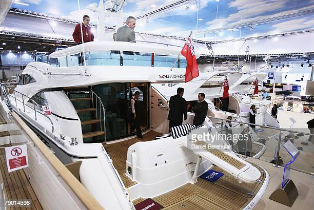 Potential buyers are shown around by consultants during the London International Boat Show on January 16 2008 Despite widespread fears of a global...