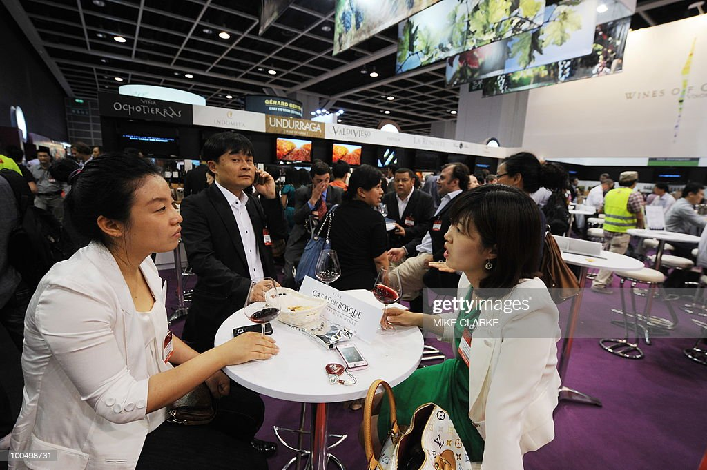 Potential buyers sample wine at VINEXPO Asia-Pacific in Hong Kong on May 25, 2010. The fourth Asian Vinexpo featuring 840 exhibitors from 32 countries opened in Hong Kong as the global economic crisis pushed exporters to focus on the world's most promising market: China. 'A little like 2009 vintage Bordeux, this Vinexpo is exceptional. There are more exhibitors and we expect more than 10,000 professionals, including a large number from China,' said chief executive Robert Beynat.