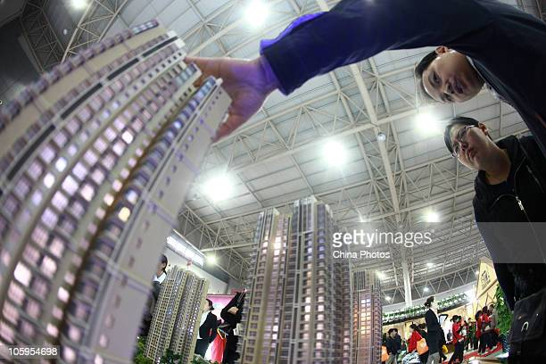 Potential buyers view models of apartment blocks at the Shaanxi 2010 Autumn Real Estate Fair on October 22 2010 in Xian of Shaanxi Province China...