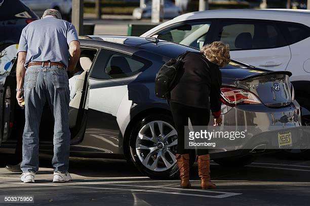 Potential car buyers view a Hyundai Motor Co Genesis luxury vehicle on the lot of the Keyes Hyundai dealership in the Van Nuys neighborhood of Los...