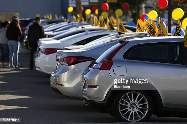 Potential car buyers view Hyundai Motor Co vehicles that sit on display for sale on the lot of the Keyes Hyundai dealership in the Van Nuys...