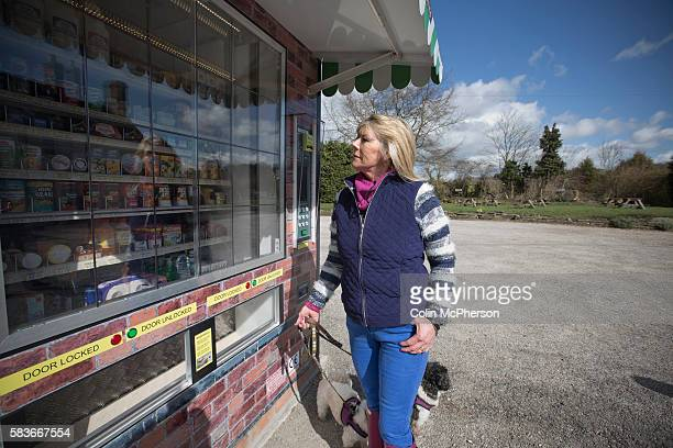 Potential customer Barbara Goodwin looking at items in the giant vending machine designed and installed by local businessman Peter Fox in the tiny...