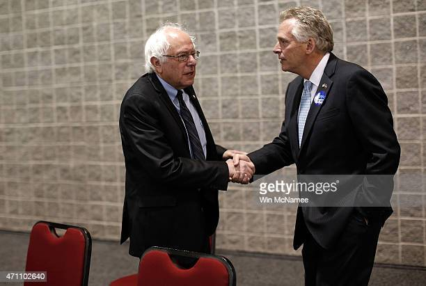 Potential Democratic presidential candidate Sen Bernie Sanders speaks with Virginia Gov Terry McAuliffe before Sanders spoke at the South Carolina...