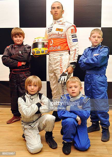 Potential future motor racing champions Archie Tillet Billy Monger Myles Apps and Dave Wooder stand with a wax figure of British Formula One world...