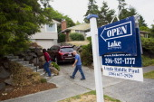 Potential home buyers arrive to an open house in Seattle Washington US on Sunday July 20 2014 Sales of previously owned US homes climbed in June to...