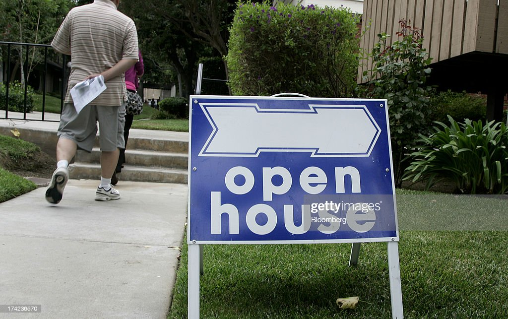 Potential homebuyers arrive for an open house in Arcadia, California, U.S., on Sunday, July 21, 2013. Sales of previously owned houses unexpectedly dropped in June, hurt by a lack of supply and rising mortgage rates that may slow the rebound in the U.S. real-estate market. Photographer: Jonathan Alcorn/Bloomberg via Getty Images
