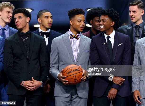Potential top draftees Lonzo Ball Markelle Fultz and De'Aaron Fox look on before the first round of the 2017 NBA Draft at Barclays Center on June 22...