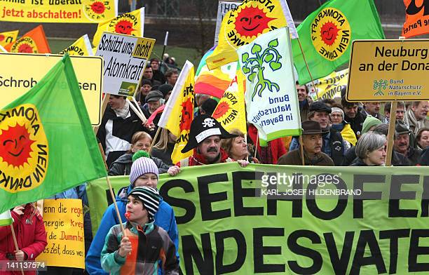 Potesters hold signs and placards demanding a swift end to the use of nuclear power during a anti nuclear demonstration in Grundremmingen southern...