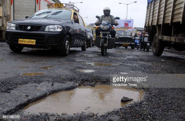 Pothole is seen on Dadar West Railway Station Flyover on Tulsi Pipe Road on Saturday