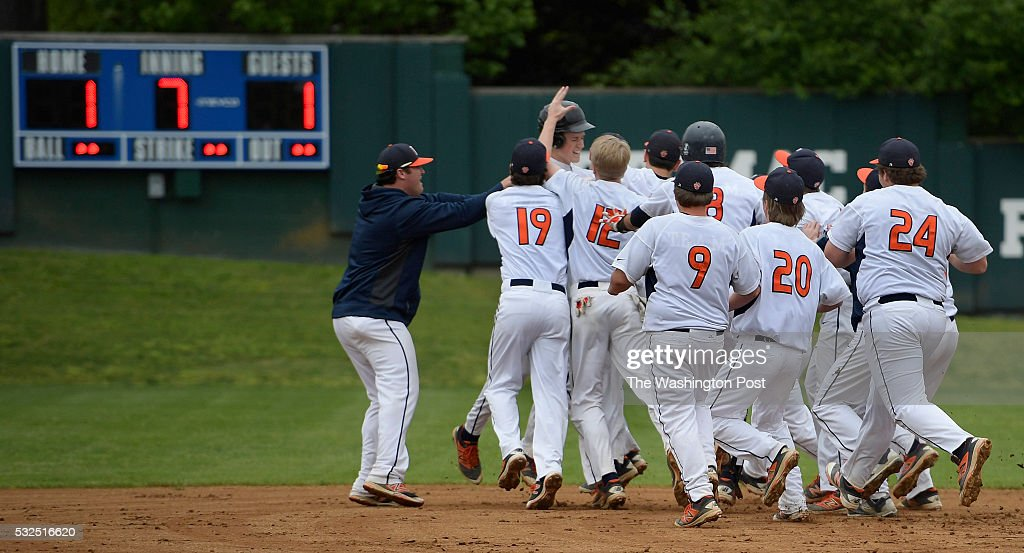 Potomac teammates swarm Ryan McAndrews aster he hit the tie breaking game winning RBI single in the bottom of the 7th inning during Potomac's defeat...