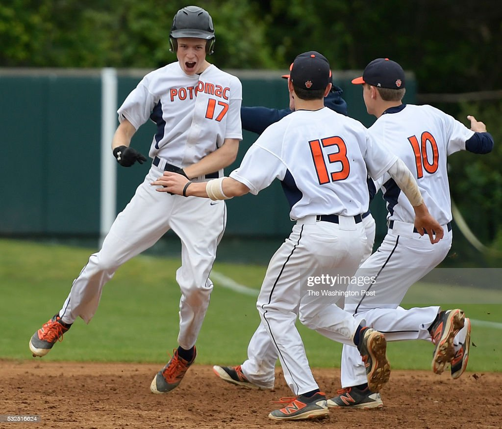 Potomac teammates swarm Ryan McAndrews left after he hit the tie breaking game winning RBI single in the bottom of the 7th inning during Potomac's...