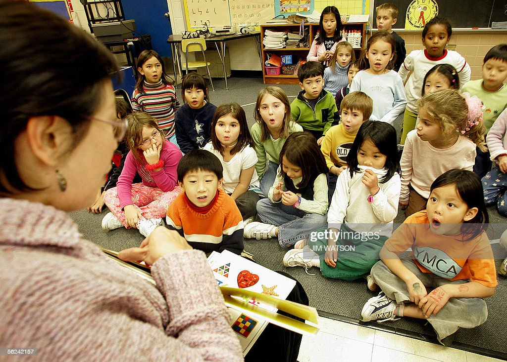 DEMAND FOR CHINESE LANGUAGE COURSES IN US SOARS Chinese Instructor Christine Wang teaches Chinese to first graders in Potomac Maryland 18 November...