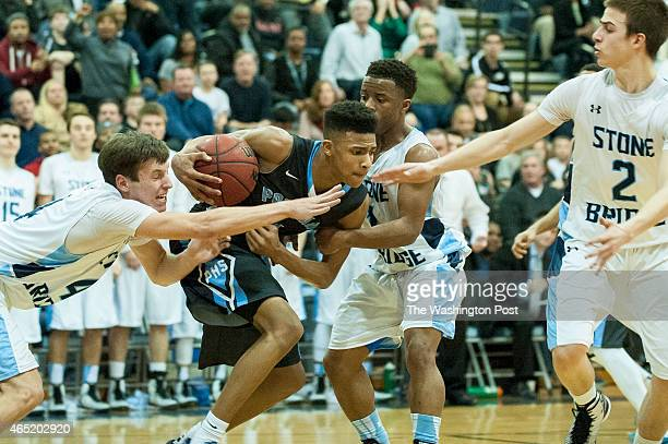 Potomac's Terrence Ward tries to move the ball up the court against the Stone Bridge defense during XXXX action in the Virginia 5A North region boys'...