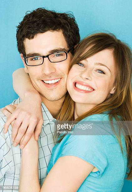 Potrait of a young couple embracing and laughing