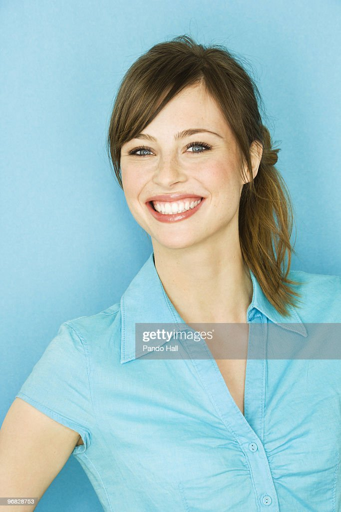 Potrait of a young woman smiling, close-up : Stock Photo