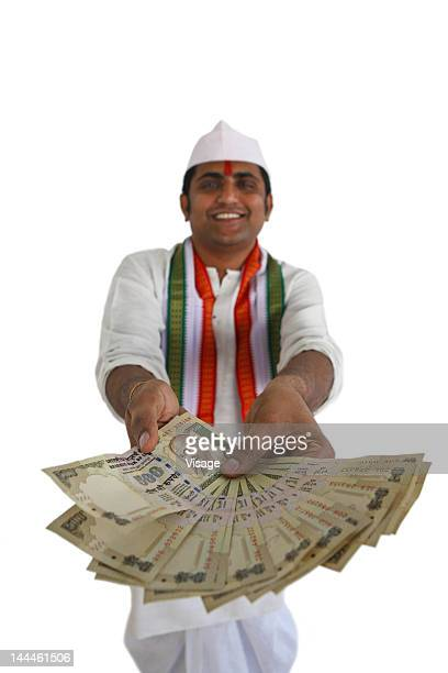 Potrait of an Indian politician with money in hands