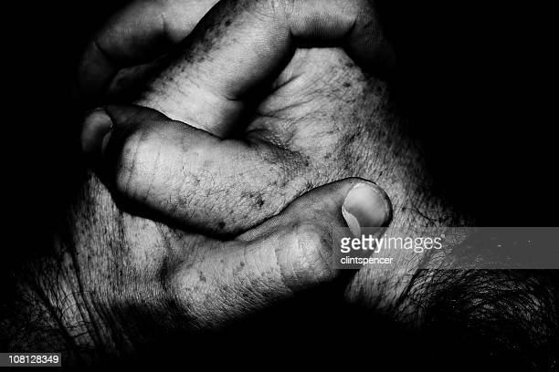 Potrait of Man's Hands Folded Together, Low Key