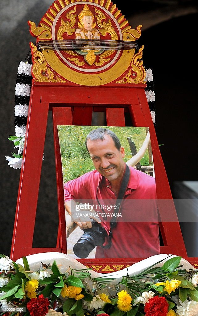 A potrait of slain Italian photograher Fabio Polenghi is displayed at his funeral at a temple in Bangkok on May 24, 2010. Polenghi, a freelance photographer and documentary maker, was shot while covering the military offensive to close down long-running 'Red Shirts' demonstrations in the capital on May 19.