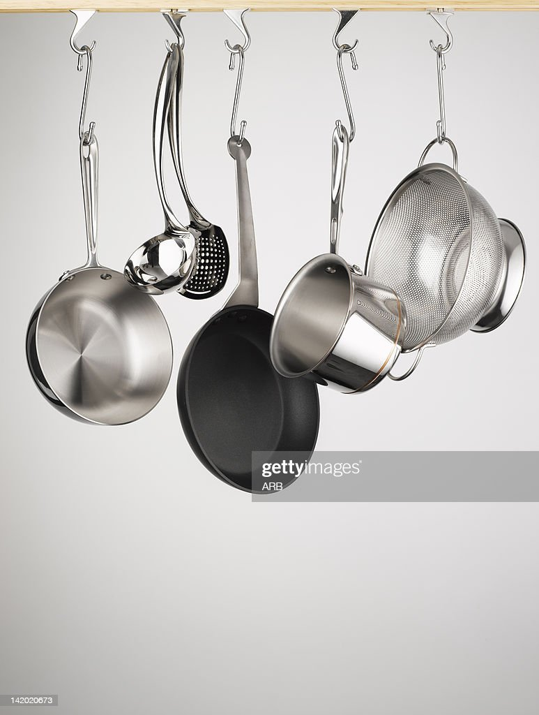 Pots and pans hanging from hooks