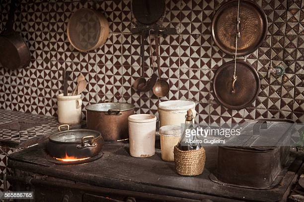 Pots and pans on cast iron stove in kitchen