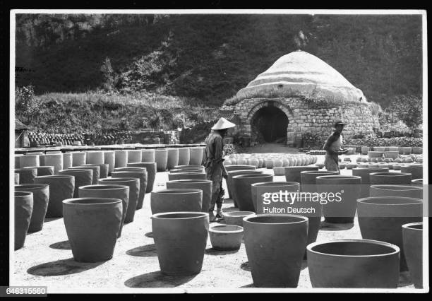 Pots are sorted into rows before a brickwork kiln