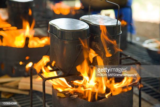 Pots with rice over fire