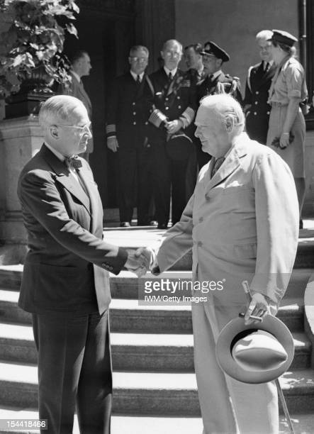Potsdam Conference Germany July 1945 Prime Minister Winston Churchill and US President Harry Truman shake hands on the steps of Truman's residence...