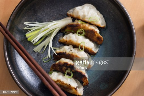Potstickers in Ceramic Dish : Stock Photo