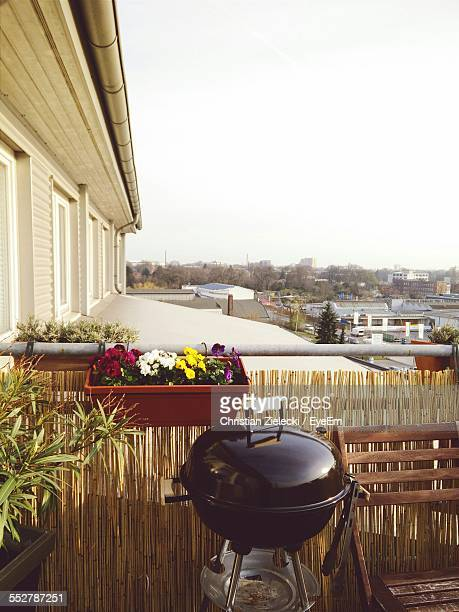 Potted Plant With Barbecue Grill In Balcony Against Clear Sky
