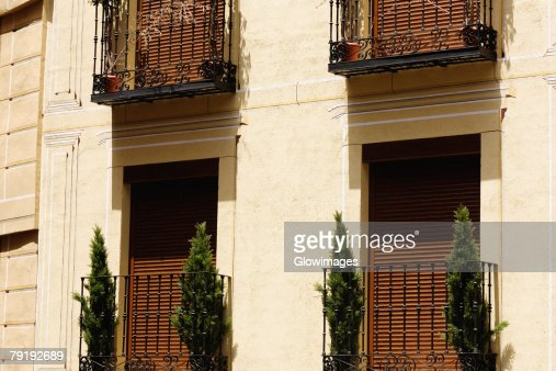 Potted plants in balconies of a house, Toledo, Spain : Stock Photo