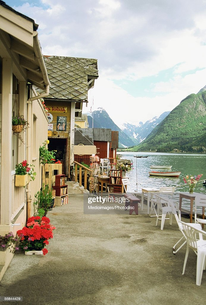 Potted plants in front of buildings, Fjaerland, Sognefjord, Norway : Stock Photo