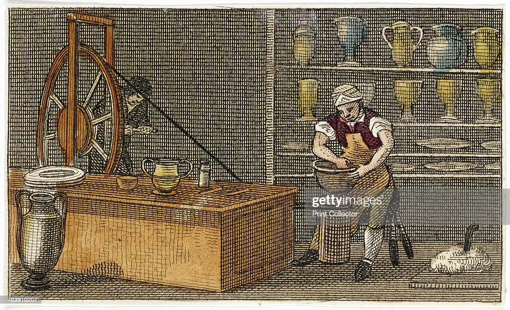 Potter at work at the Wedgwood's Etruria factory Hanley Staffordshire c1830 An assistant turns a wheel to operate the belt driving the potter's wheel...