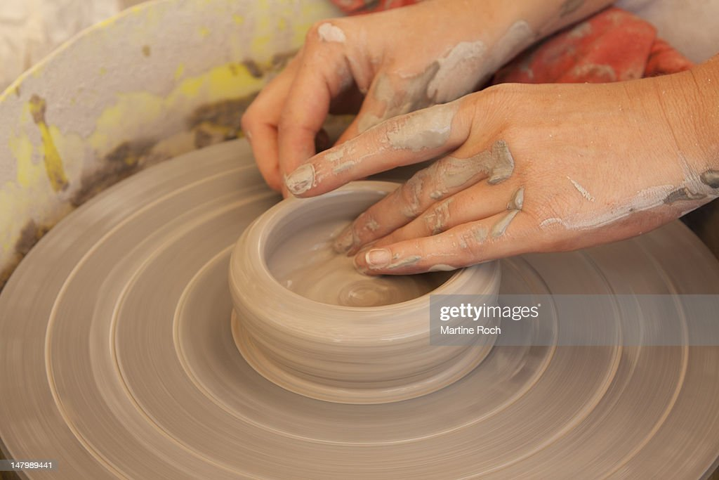Potter hands : Stock Photo