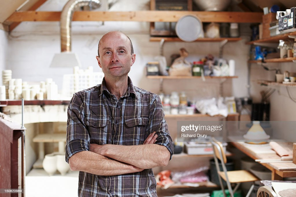 Potter in his studio : Stock Photo