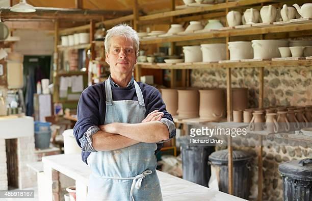 Potter in workshop