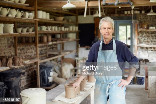 Potter in workshop