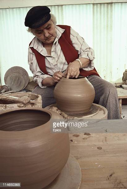 Potter Janet Leach at work with some clay pieces in St Ives Cornwall England June 1987