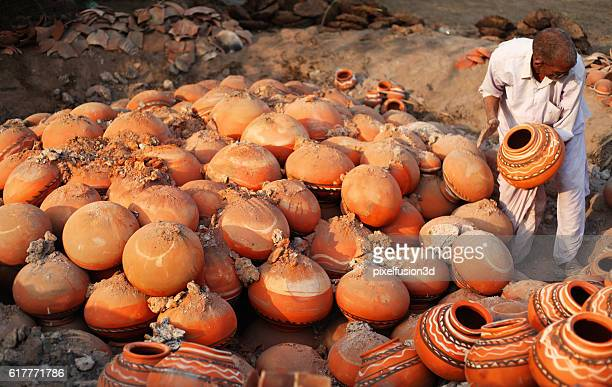 Potter remove the fired clay pots