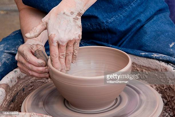 Potter Smoothing a Clay Bowl