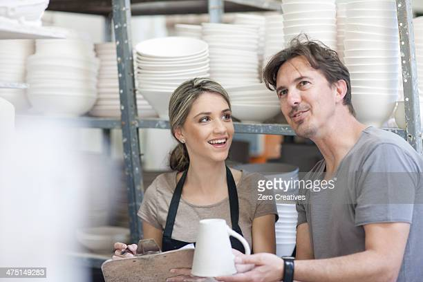 Potters chatting at crockery factory
