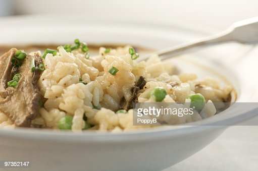 Pottery Bowl of Risotto with Porcini Mushrooms and Peas