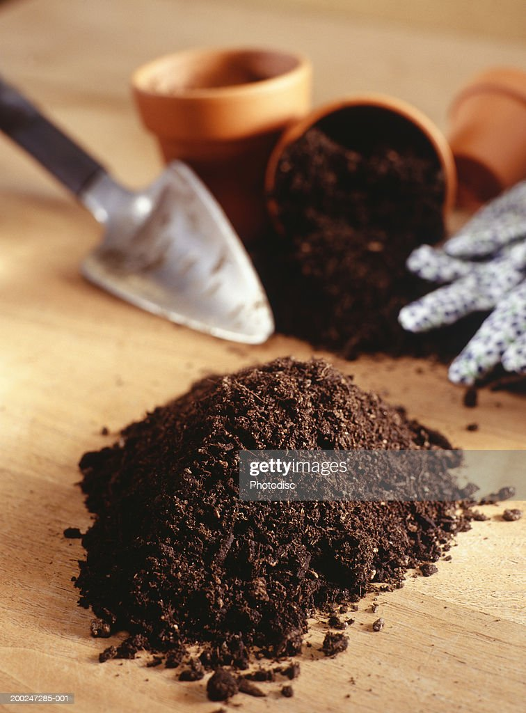 Potting soil, flower pots and trowel, elevated view : Stock Photo