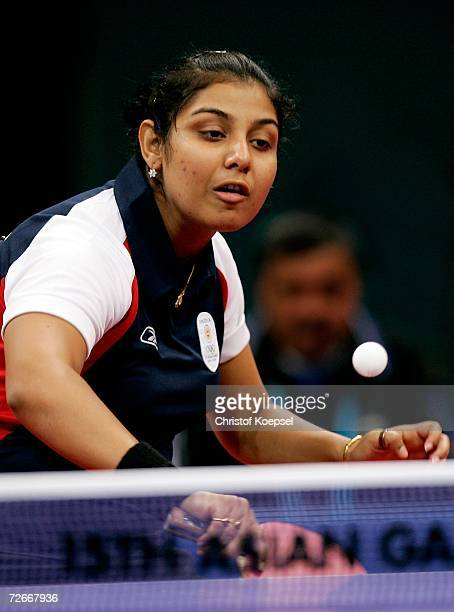 Poulomi Ghatak of India returns a shot during the Women's Team Round One at the 15th Asian Games Doha 2006 at AlArabi Indoor Hall November 29 2006 in...