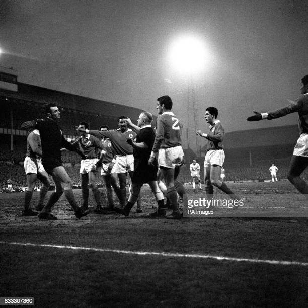 A Poulsen the Danish referee finds himself surrounded by protesting players of Benfica after Jimmy Greaves had netted the ball The referee disallowed...
