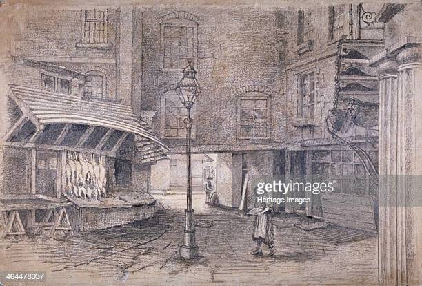 Poulterer's shop in Clare Market Westminster London c1850 View with a figure walking past a lamppost