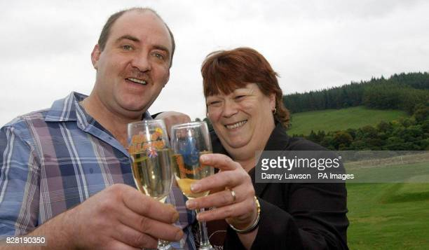 Poultry welfare worker Andrew McAllister with his wife Doreen celebrate winning a 42 million share of the jackpot in last Friday's Euro Millions draw...