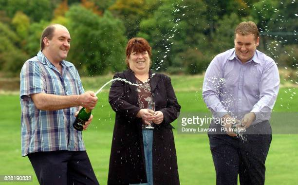Poultry worker Andrew McAllister with his wife Doreen and son Darren celebrate winning a 42 million share of the jackpot in last Friday's Euro...