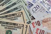 United States Ten and Twenty Dollar notes next to Ten and Twenty UK Pound Notes