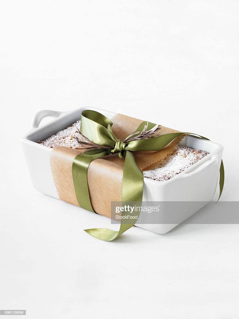 A Pound Cake in a Ceramic Loaf Pan and Tied with a Ribbon
